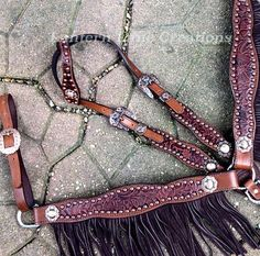custom fringed tack set with antique copper hardware