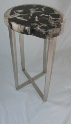 Indonesian petrified wood slice top on brushed nickel base side table. www.balsamoantiques.com