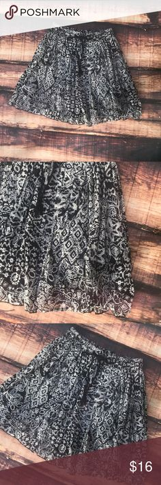 Black & White Pattern Loose Midi Skirt Flouncy skirt with a beautiful black and white pattern. Dark colors, but still flirty! Great length at 18.5 inches. Elastic waist for the perfect fit. Fully lined. Perfect condition Xhilaration Skirts