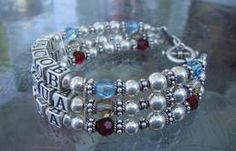 """This baby bracelet can be made in single, double and triple width.  Made with Sterling Silver cube alphabet beads, birthstone swarovski crystals, and sterling silver beads and catch. Custom made....please state name(s) and birthday(s) Measures:  7 - 8 """" as needed 1 Name:  $70    2 Names:  $90          3 Names:  $110 Note:   2-3 weeks for delivery    http://www.cjjewelssite.com/Products.html"""