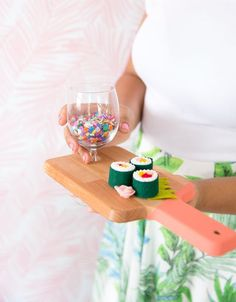 Serve your appetizers in style with this DIY cutting board cocktail plate.
