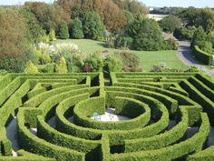 Looks like Hever Castle?  Actually the Mazepark in Sussex. A copy of Hever Castle but very well done. The paths are edged with wood and the maze looks very well kept.