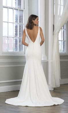 Shop Theia Bridal Lynda 890672 bridal gown here! Lynda features a v-neckline, buttons down the back, a fit-and-flare silhouette, and a low back. Bridal Dresses, Wedding Gowns, Theia Bridal, Wedding Dress Low Back, Best Gowns, Contemporary Dresses, Bridal Boutique, Bridal Collection, That Way