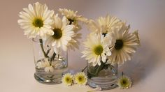Fragrant spring flowers look great in recycled candle jars.