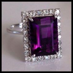 Superb Emerald Cut, Amethyst ring in a Diamond surround. The magnificent center gemstone is a fine, medium dark purple Amethyst. The vivid gemstone Purple Rings, Purple Jewelry, Amethyst Jewelry, I Love Jewelry, Jewelry Rings, Jewelry Accessories, Fine Jewelry, Jewlery, Schmuck Design