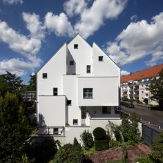 Haus KLR by Archequipe is a townhouse with a gabled facade that steps back and forth
