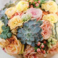 Succulents. Roses, hypericum berries and ranunculus. Wedding flowers UK edition Jan/ Feb 2012