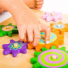 Another new product of ours is this funky wooden spinning cogs & gears toy.   Bright and colourful, it's perfect to stimulate fine motor skills development amongst children with special needs. Children in a wheelchair can play with it on their lap, and the chunky pieces are easy to grasp and hold.