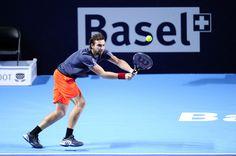 Ernests Gulbis Photos - ATP Swiss Indoor Basel - Day Two - Zimbio