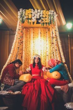 A bride who wore red on her mehendi, a groomglowing with love and a family that celebrated their union with loads of laughter and fun, this Delhi wedding totally stole our heart! Desi Wedding Decor, Wedding Hall Decorations, Luxury Wedding Decor, Marriage Decoration, Wedding Mandap, Sikh Wedding, Wedding Ideas, Punjabi Wedding Decor, Wedding Receptions