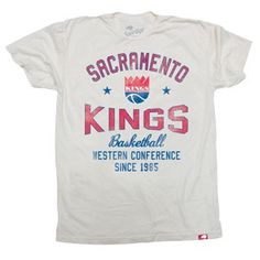 Sacramento Kings Retro Regatta Vintage T-Shirt from Sportiqe is a 100% cotton super soft t-shirt and features a retro logo screen print graphic across the front chest and a small jock tag on the lower left hem.