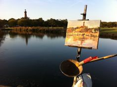 Anne painting the Currituck Lighthouse in Corolla, North Carolina. Catepetl Art and Frame  Anne Gibson Snyder