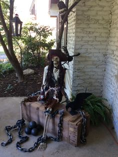 Pirate chained on old ammo box