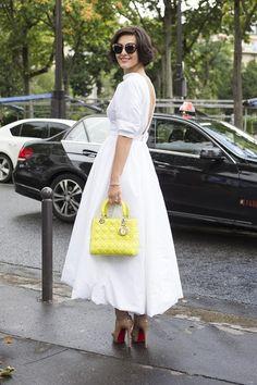 "Dasha Zarivnaya, editor  ""I'm wearing an Ulyana Sergeenko dress with Christian Louboutin shoes and carrying a Christian Dior bag."""
