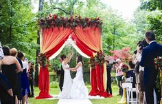 Red Fabric and Floral Wedding #chuppah