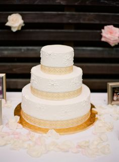 Gold and White Wedding Cake With Geometric Border