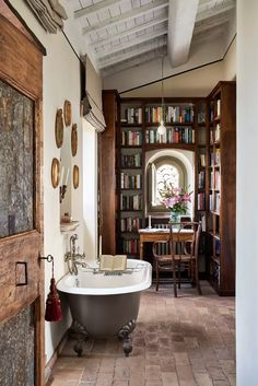Life in an art-filled former palace in Italy, accessible only by foot An unusual bathroom with a freestanding bath amidst an alcove of bookshelves Unusual Bathrooms, Master Bathrooms, White Bathrooms, Luxury Bathrooms, Dream Bathrooms, Contemporary Bathrooms, Home Interior, Interior Design, Italy House