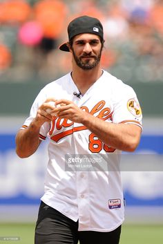 WWE wrestler Seth Rollins throws out the first pitch before a baseball game between Baltimore Orioles and the Los Angeles Angels at Oriole Park at Camden Yards on May 2015 in Baltimore, Maryland. The Orioles won Seth Rollins T Shirt, Wwe Seth Rollins, Seth Freakin Rollins, Wwe Pictures, Wwe Photos, Roman Reigns Dean Ambrose, Baltimore Orioles, Baltimore Maryland, Wwe World
