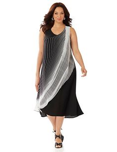 This on-trend dress is all about movement. Soft georgette creates a fluid drape, while a breezy overlay features a curved line design. An asymmetrical hemline completes the look. V-neckline. Sleeveless. Catherines dresses are expertly designed for the plus size woman.  catherines.com