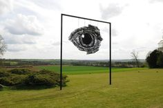 Surrealist wire sculptures by Sophie Ryder wire sculpture upper playground UK surrealist Sophie ryder optical illusion eyes art installatio...