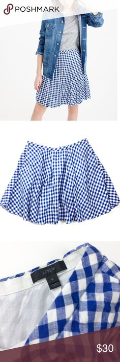 """J. Crew • Gingham Pleated Skirt J. Crew Gingham Pleated Skirt in a blue + white print in a size 8. Waist of 30"""" and length of 18"""". Features include a 100% linen exterior, front pockets, and back-zip closure. Excellent condition -- no rips, fading -- only flaw is some stains on the interior (see last photo). Retail $88. J. Crew Skirts"""