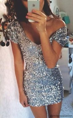 A Sparkling Silver Mini Dress The V-neck dress made of cotton with sequins that carefully crafted into it. What makes it look soo cool? Wear it on Valentine's Day to shine when you dancing because this is the dress you are going to love.