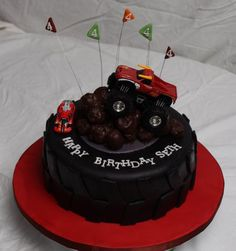"Monster truck birthday cake - thin mint truffles for ""rocks"" Monster Truck Birthday Cake, Tire Cake, Car Themed Parties, Truck Cakes, Decadent Chocolate Cake, Birthday Cake Decorating, Themed Cakes, Party Cakes, Cake Designs"