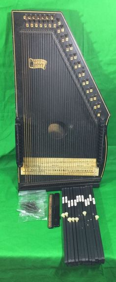 Excellent 1961 Model 73 Oscar Schmidt Autoharp, 36 string/12 Chord, all strings and accessories are present. 5 of the small handles are missing off of the chord bars, otherwise overall Excellent Condition! | eBay!