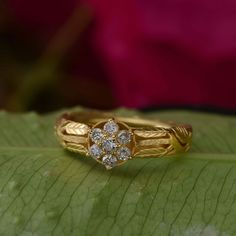 This divine engagement ring has been handmade in our workshops. It is made in 18ct gold and is embedded with full cut diamonds. The shank has exquisite hand engraving work on it using botanical motifs.  The ring can be resized on request.  Ring size - O  Dimensions - 13mm x 13mm  Alternative Wedding Jewellery, Alternative Engagement Rings, Hand Engraving, Bridal Collection, Anniversary Gifts, Gemstone Jewelry, Diamond Cuts, Gemstones, Shank