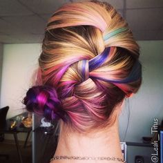 I dyed my hair purple, teal, and magenta in an ombre style and my lovely…