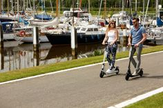 Riding the electric scooter Vesper
