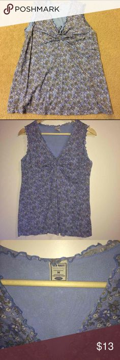 Super Cute Sleeveless Floral Maternity Top Gently worn. Old Navy brand Sleeveless Floral Maternity Shirt Size M. Perry Winkle with floral print. Ruffled edges.  No rips stains or tears. Non smoking home. Total length of shirt is about 25 inches long.   Don't like my price? MAKE ME AN OFFER!!!!!    Look forward to working with you! Old Navy Tops Tank Tops
