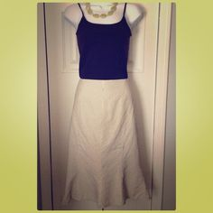 """Ralph Lauren stripped skirt Cream and black stripped skirt. Flares a bit at bottom of skirt. Measurements: waist= 16 1/4"""", length= 25 1/2"""". Side zipper. (Side clasp works but is a bit twisted see pic-isn't necessary to close skirt). 73% cotton, 27% linen. Has lining. Ralph Lauren Skirts"""