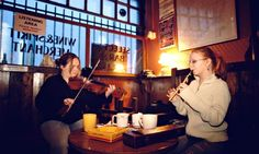 Fiddler and Flute player playing Pub Music at The Cobblestone Dublin Ireland