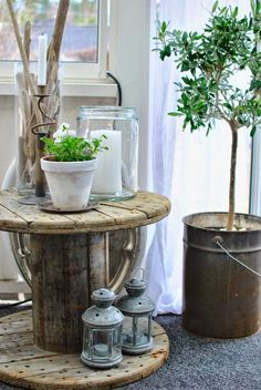 #PinMyDreamBackYard - love the rustic spool table and lantern look for the deck.