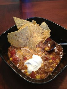 Crockpot Taco Soup   2 lbs ground beef browned   1 onion, chopped   1- 14.5 oz can whole kernel corn   2- 16 oz cans of ranch style beans   3 cans of diced tomatoes (may used one reg can diced, 1 can rotel, & 1 can diced garlic/onion)   1 pkg taco seasoning   1 pkg Hidden Valley ranch dressing mix