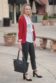A polka dot blouse looks clean and professional when paired with a red blazer. Find out how you can get dressed for work and feel stylish and professional at the same time.