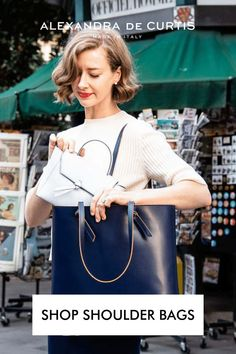 Shop Italian Leather Handbags and Bucket bags. Get 10% off your first order at alexandradecurtis.com Italian Leather Handbags, Designer Leather Handbags, Navy Bags, Blue Bags, Italian Street, Bucket Bags, Blue Handbags, Designer Shoulder Bags, Italian Fashion
