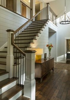 Metal balusters and wood rail and newel posts.