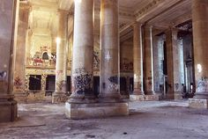 """""""Detroit Train Station - view of the ticket windows"""" I'm so sad that all the hard work that went into handcrafting plaster moldings and the painstaking time to produce detail of that level was ruined by kids running around with two-dollar home depot spray paint. Go tag your bathroom mirror, you childish fiends, and leave our country's heritage alone."""