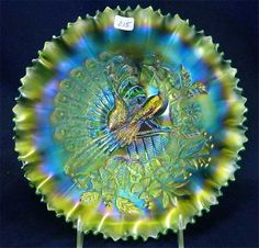 """Northwood """"Peacocks on the Fence"""" emerald green carnival glass pie crust-edge bowl. My Glass, Glass Art, Antique Glassware, Fenton Glassware, Rainbow Glass, Indiana Glass, Vintage Bottles, Carnival Glass, Glass Collection"""