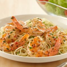 Lawry's® Herb & Garlic Marinade adds zesty garlicky flavor to shrimp. Serve over spaghetti for a quick Italian dinner.