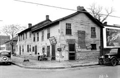 OLDEST BUILDING IN LITTLE ROCK: picture taken in the 1930s of the Hinderliter Grog Shop, at 3rd and Cumberland Streets.   Jesse Hinderliter began the grog shop around 1827 as a cypress log structure. The building served as both his business and the home he shared with his wife. The building has been restored and is now part of the Department of Arkansas Heritage's Historic Arkansas Museum.