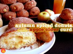 Autumn Spiced Donuts with Apple Cider Curd: Fluffy and rich brioche dough rolled in sugar and warm spices, and filled with a tart spiced apple cider curd filling!