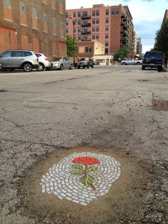 Artist Solves Chicago's Potholes problem with Mosaic Flowers