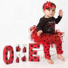 What a cool party/photo prop! This O-N-E stands 8 tall and is cut from super chunky wood! Stands great on its own.  The back is NOT painted.  Perfect for your Lady Bug themed birthday party! Not turning 1? I can do any age...just add $15 for each additional letter needed! Contact me for a custom listing. Not your theme? No problem. Contact me for a custom ONE :)   Thanks for looking