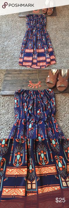 Strapless printed dress. Cute patterned strapless dress. Dress up or down. Worn once. Pair with wedges or heels for dressy look. Sandals and jacket for day wear. Buttons Dresses Strapless