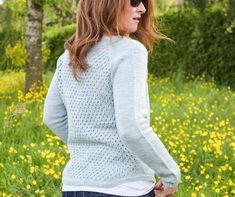 """Stayin' Cool is a top-down, seamless sweater worked in the round. The lacy stitch pattern for the back is striking but not complicated! The same pattern is repeated in the front at the neck line. A beautiful and feminine sweater to stay cool all summer long.Choose a size that has between 2-5"""" or 5-13 cm of ease at the bust.Sample shown using Polo"""