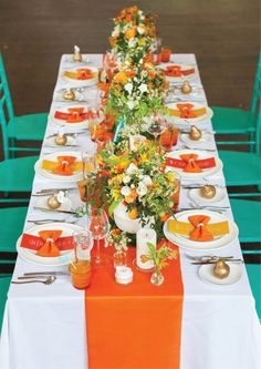 Orange wedding table ... Shades of yellow, orange and green with golden pears to welcome guests at the table!