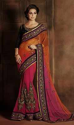 Immerse yourself in elegance donning this pink and orange shade net dhupian silk embroidered sari. The handwork and stones work appears to be chic and great for any get together. #PreetyDesignerSarree